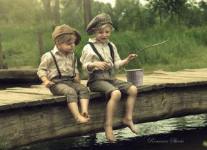 Two brothers fishing on the side